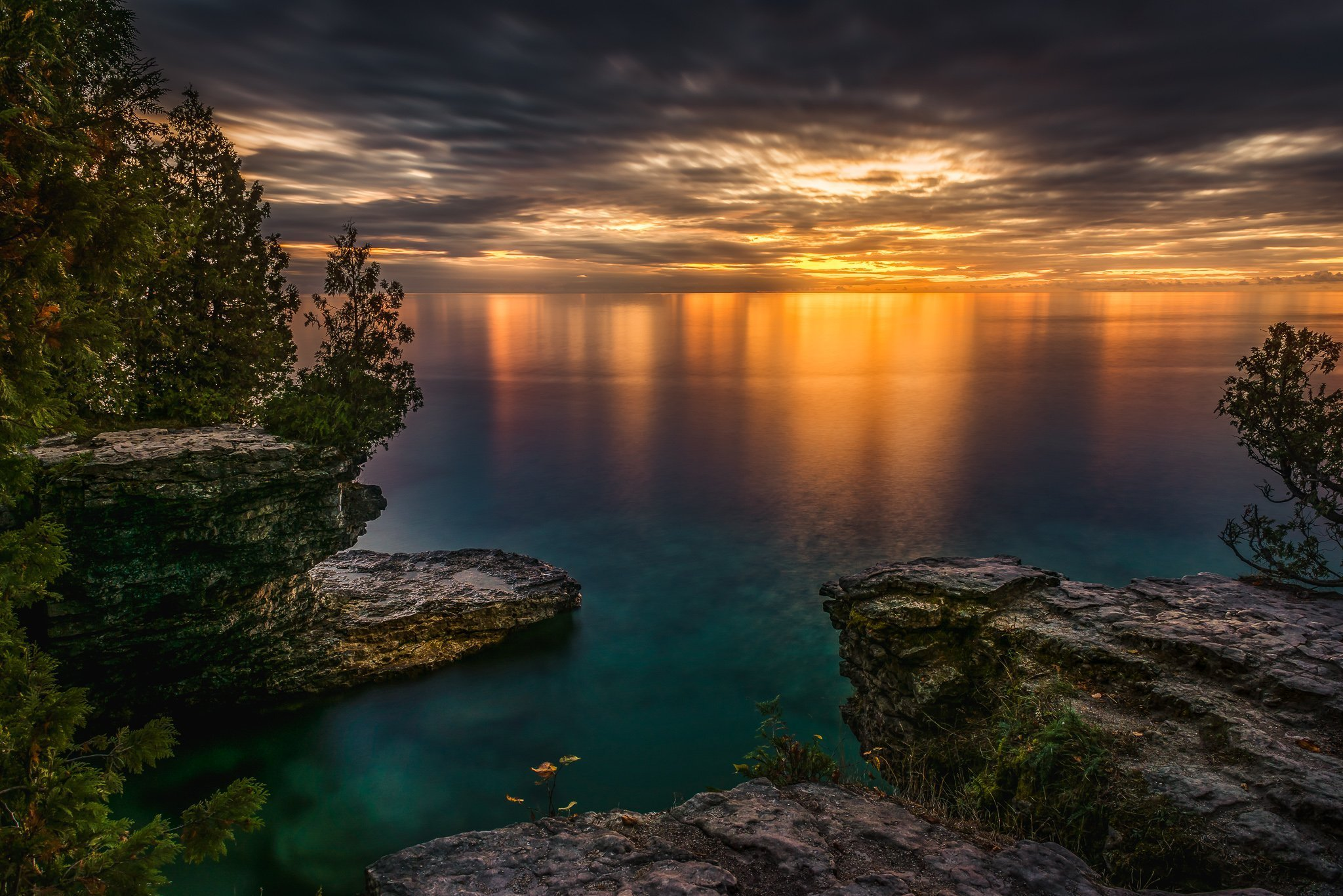 sunrise at cave point county park in door county, wisconsin